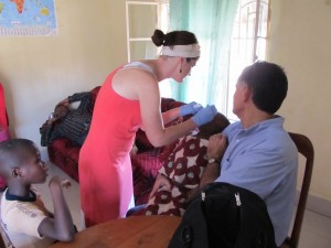 Megan administering eye drops for Ange for trachoma
