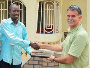 Here Hosea receives a laptop computer kindly donated by BDC